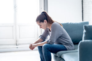 Getting a Loved One into Rehab | Root Causes of Addiction | Find Addiction Rehabs | Woman contemplating her options regarding IOP